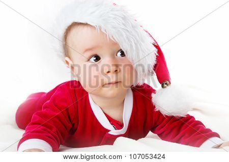 Baby on white background in santa costume