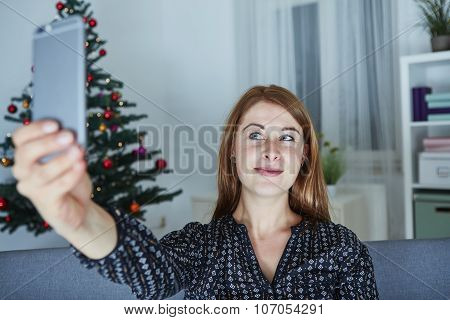 Girl Is Taking A Selfie With Smartphone