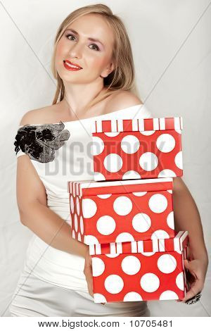 Woman In White Dress And Red Boxes.