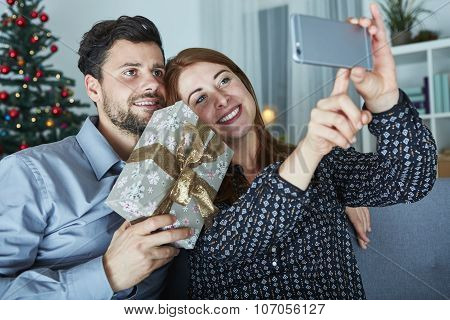 Happy Couple Is Taking A Selfie With Gift