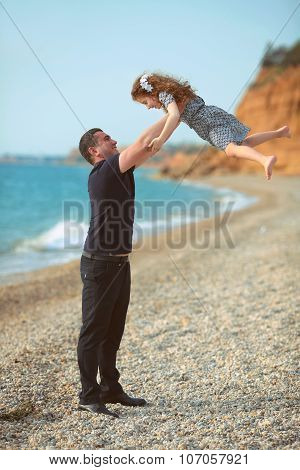 Father Toss Up Daughter Playing Together On The Beach Carefree Happy Fun Smiling Lifestyle