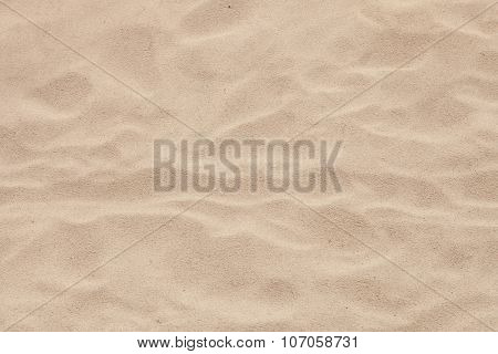 Sand beach with waves formed by the air