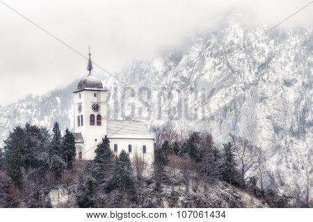 Cristian Church On A Snow Covered Hill In Winter Near Salzburg, Austria