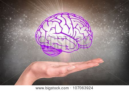 Drawn brain hovered over the human hand