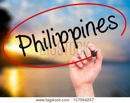 Man Hand writing Philippines with black marker on visual screen.