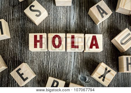 Wooden Blocks with the text: Hello (in Spanish)