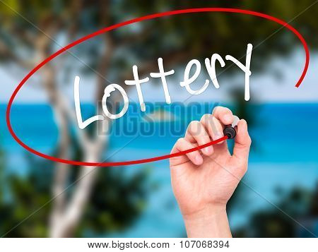 Man Hand writing Lottery with black marker on visual screen.