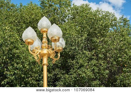 White Lamp On Golden Pillar