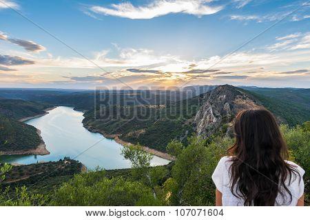 Woman Watching The Beautiful Landscape At Sunset