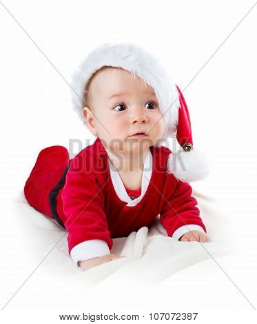 Baby isolated on white background in santa costume
