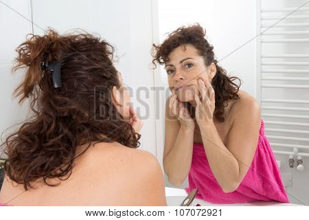 Woman Watching In Mirror Her Skin