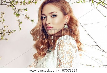 Gorgeous Woman With Blond Curly Hair Wears Elegant Dress And Bijou