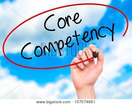 Man Hand writing Core Competency with black marker on visual screen.
