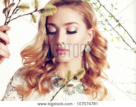 Young Woman With Blond Curly Hair Wears Elegant Lace Dress And Bijou