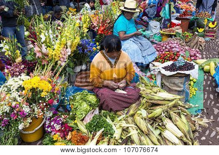 Locals in a market in the city of Pisac in the Sacredy Valley.