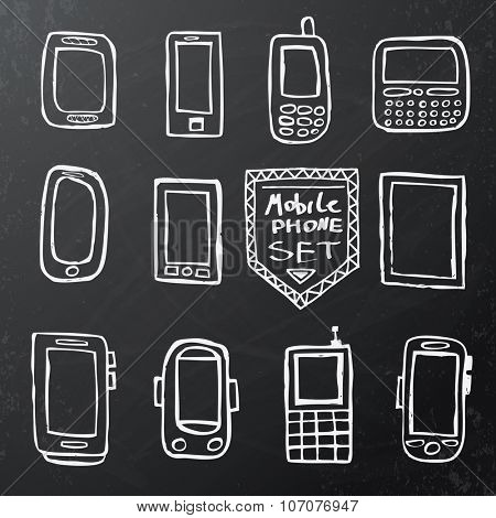 Hand drawn set of isolated mobile gadgets on black chalk board.