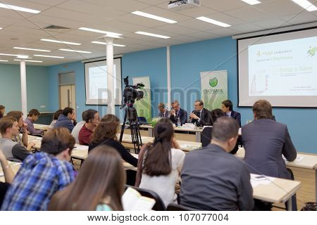 ST. PETERSBURG, RUSSIA - OCTOBER 21, 2015: Students of Higher School of Economics during the meeting with head of North-West bank. Remote services of Sberbank was presented at the meeting