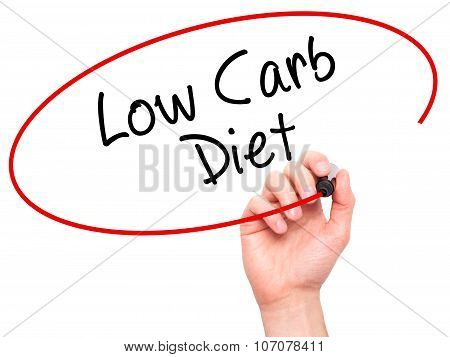 Man Hand writing Low Carb Diet with black marker on visual screen