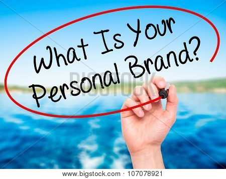 Man Hand writing What Is Your Personal Brand? with black marker on visual screen.