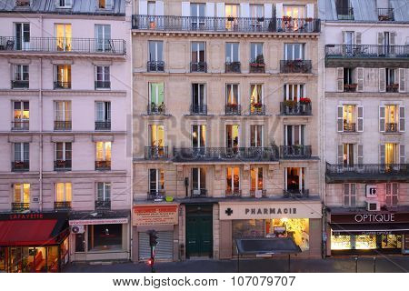 PARIS, FRANCE - SEP 09, 2014: The view from the facade of building on street Rue La Fayette in Paris in the evening