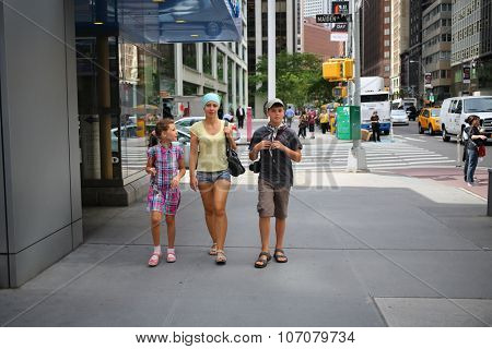 NEW YORK, USA - SEP 08, 2014: Woman with her son and daughter (with model release) walking on the street in New York