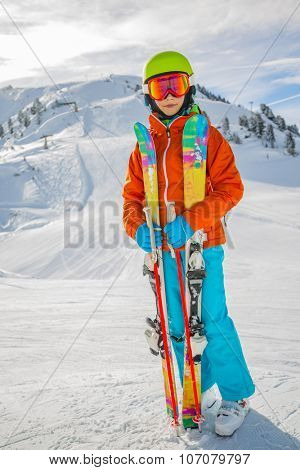 Ski, skier girl on the ski slopes