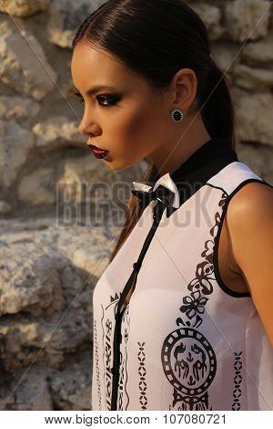 Sexy Elegant Woman With Dark Hair Wearing A White Shirt