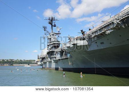 NEW YORK, USA - SEP 07, 2014: Competition Standup paddle boarding near the US aircraft carrier Intrepid