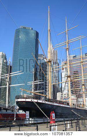 NEW YORK, USA - SEP 07, 2014: Peking Museum Ship on the pier before the skyscrapers in the South Street Seaport