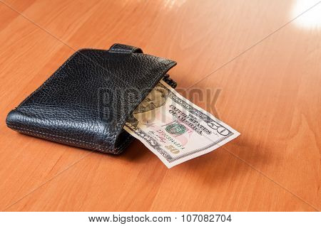 Fifty Dollars Of On Wooden Plank With Wallet