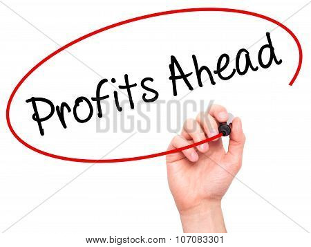 Man Hand writing Profits Ahead with black marker on visual screen.