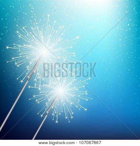 Starry sparklers on blue background