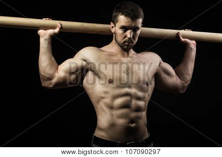 Muscular Man With Crossbar