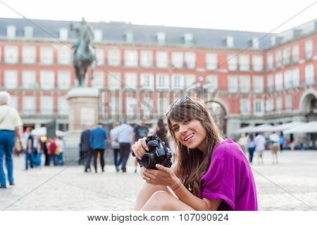 Woman tourist holding a photo camera
