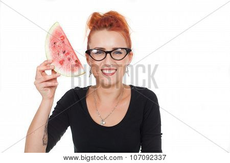 beautiful, young healthy, happy woman red hair smiling while holding a watermelon in his hands. Diet