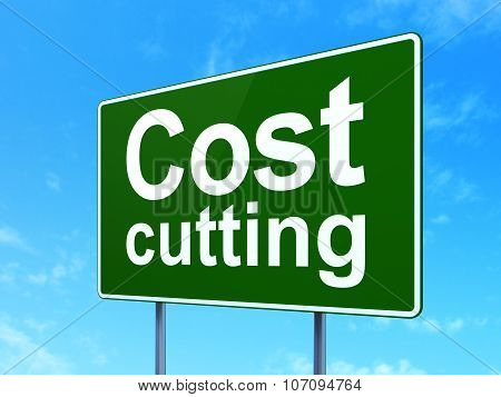 Business concept: Cost Cutting on road sign background