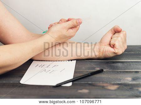 Man Holding A Syringe