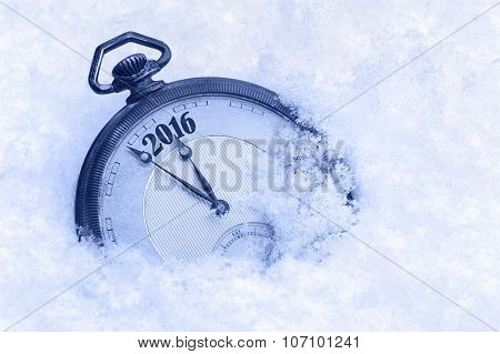 Pocket watch in snow New Year 2016 greeting card