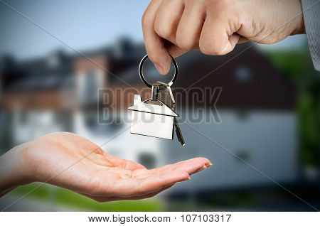 Man Gives A Woman The Keys To A New Home