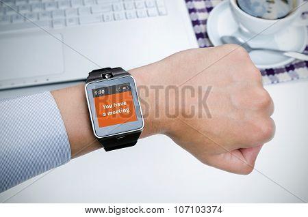 Businessman Working With Smart Watch In Restaurant