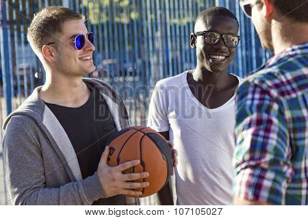 Group Of Friends Playing Basketball.