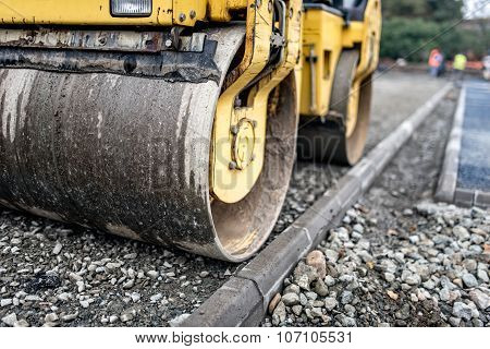 Heavy Tandem Road Roller Compacting Layers Of Gravel On Road Construction Site.