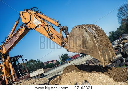 Industrial Bulldozer Demolishing Buildings And Working On Construction Site