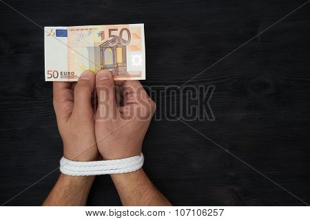 Man Holding Money With Hands Tied Up