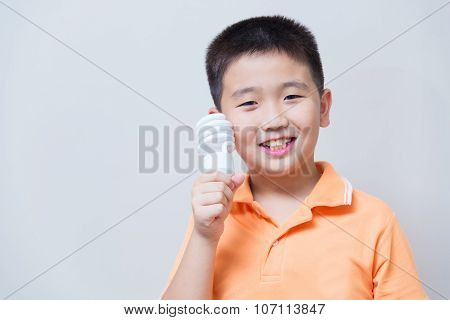 Asian Boy Holding A Lamp, Energy Saving Lamp,