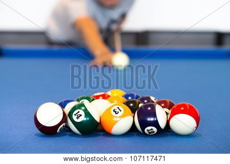 Man Opening Frame Of The Billiard On Blue Table