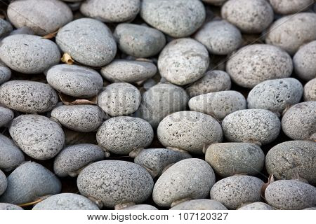 Charcoal lava pebbles background