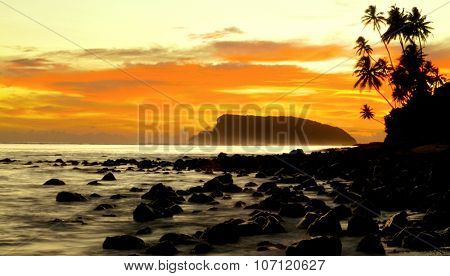 Sunset on a Tropical Island Tranquil Scene Concept