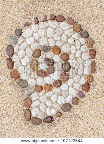 Shell Shape Stone Decorated On Gravel Floor Texture.