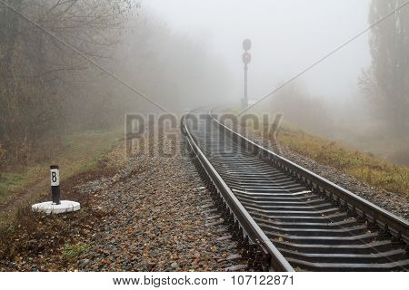 Autumn Railway in Fog.